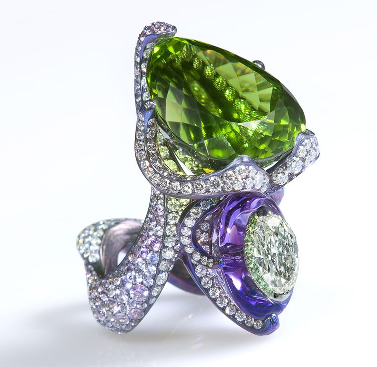 Nuwa ring by Wallace Chan shows off the jeweler's skills in combining the colors of a 45 Ct peridot, amethyst and diamond. Nüwa is a goddess in ancient Chinese mythology known for creating mankind and repairing the wall of heaven. She sealed the broken sky using stones of seven different colors.