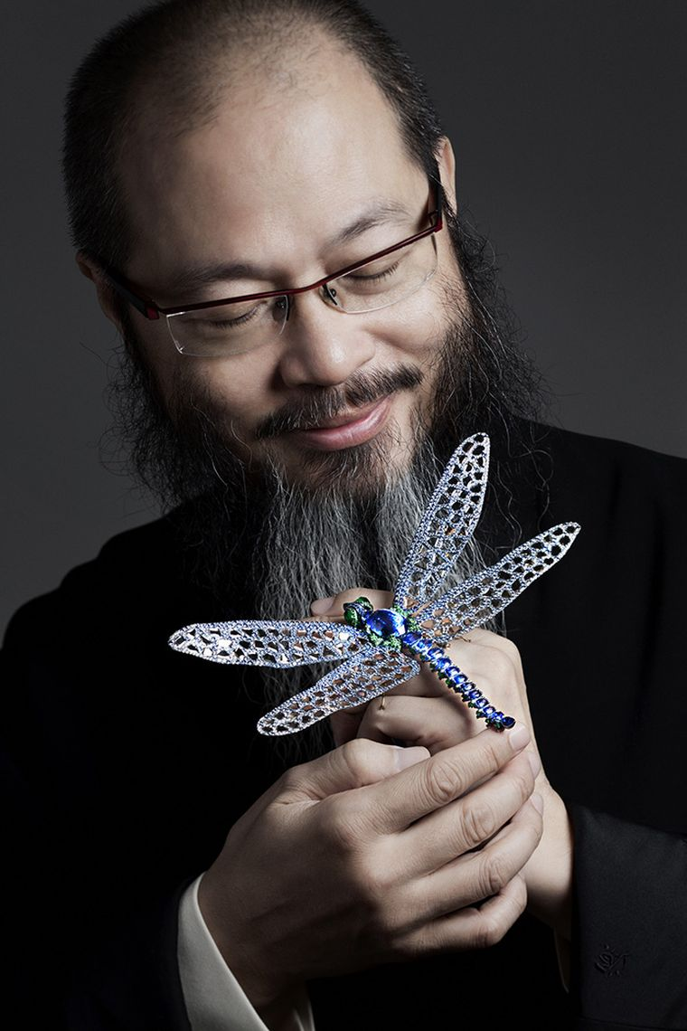 Wallace Chan with a light as air titanium dragon fly brooch.