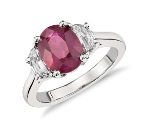 Oval Ruby and Half-Moon Diamond Three-Stone Ring in Platinum (3.04 ct center)     Classic and beautiful, this ruby and diamond ring features an oval ruby nestled between two brilliant half-moon diamonds set in enduring platinum.