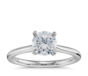 1 Carat Preset Petite Solitaire Engagement Ring in Platinum     This classic engagement ring features a preset 1-carat round near-colorless center diamond, set in an enduring platinum solitaire setting. Each ring will be accompanied by a GIA grading report and a complimentary appraisal.