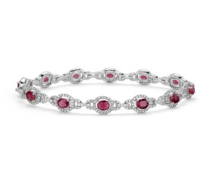 Ruby and Diamond Halo Bracelet in 14k White Gold (5x4mm)     Captivating in color, this bracelet features vibrant ruby gemstones accented with a halo of sparkling round diamonds framed in 14k white gold.