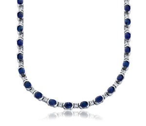Sapphire and Diamond Necklace in 18k White Gold (5x4mm)     Forty-four vibrant blue sapphires are highlighted with a semi-bezel setting, and interspersed with brilliant prong-set diamonds.