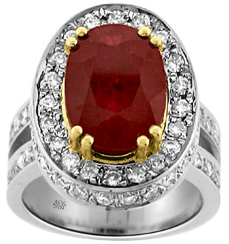 This amazing ruby and diamond ring will stun your senses with its impressive demeanor. The center of this fine work of art features a gorgeous, genuine oval cut ruby with a massive weight of 7.02 carats. This exceptional ruby gleams with an intense and vibrant color that will demand admiration. Surrounding the ruby on the bezel, and on the side of the bezel, as well as down the shank are glittering pave set round cut diamonds. These diamonds have a total combined weight of 1.50 carats and ranges in clarity from Vs2-Si1 with a color grade ranging from H-I. This imposing ring is made of 14kt. white and yellow gold with a total gold weight of 13.20 grams.