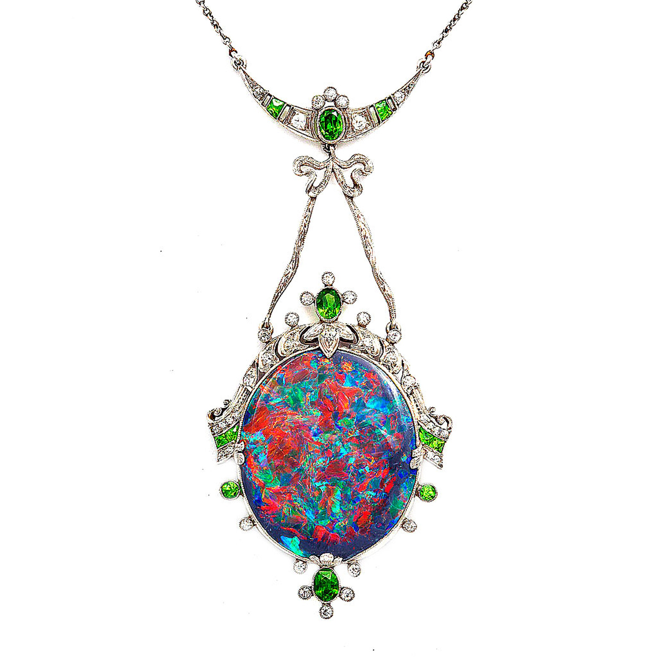 A La Vieille Russie antique black opal pendant set in a platinum mount with demantoid garnets and diamonds, American, circa 1915.