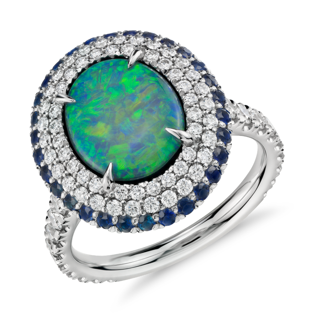 Black Opal and Diamond and Sapphire Halo Ring in Platinum (2.33 ct center) (11x9mm)at Blue Nile Distinctly glamorous, this one-of-a-kind gemstone ring features a stunning 2.33ct black opal surrounded by a halo of pavé-set diamonds and blue sapphires framed in enduring platinum.