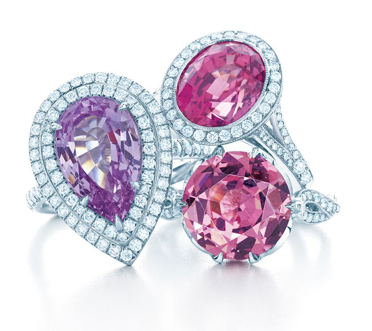 Tiffany & Co. rings in diamond and platinum settings, from the Blue Book Collection, set with (clockwise from left) a pear-shaped violet spinel, an oval pink sapphire and a round pink spinel.