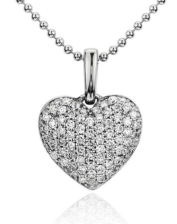Diamond Heart Pendant in 14k White Gold (1/4 ct. tw.) A timeless design makes this heart pendant enduring, and features 71 pavé-set diamonds with a 14k white gold bead chain necklace.