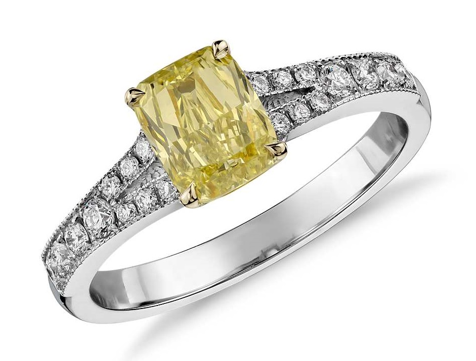 Fancy Yellow Cushion Diamond Ring in 18k White Gold (1.06 ct) Decadently detailed, this one-of-a-kind diamond ring showcases a fancy intense yellow cushion cut diamond framed by micropavé diamonds. Accompanied by a GIA Diamond Grading Report for the diamond.