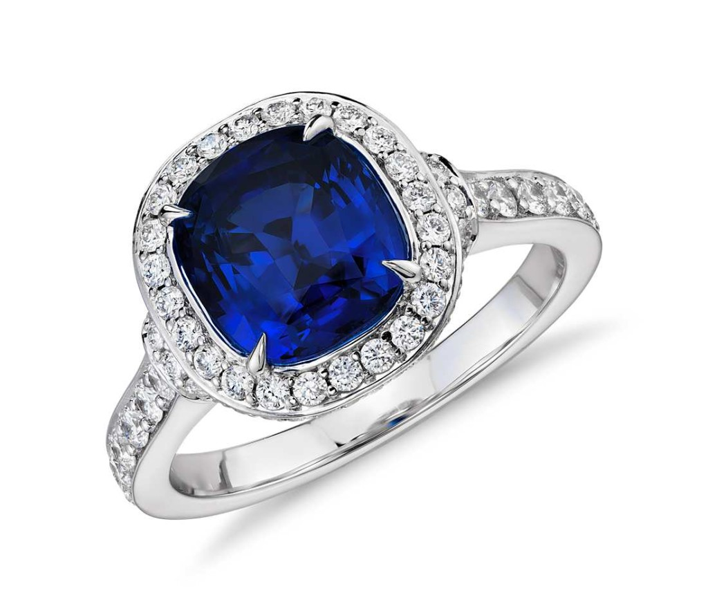 Cushion-Cut Sapphire and Diamond Halo Ring in 18k White Gold (2.58 ct center) Distinctly glamorous, this sapphire gemstone ring showcases a 2.58 carat cushion-cut sapphire and a brilliant halo of pavé-set round diamonds framed in enduring 18k white gold.