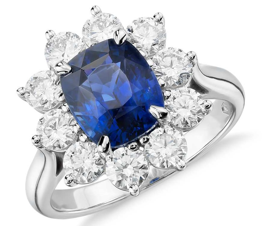 Sapphire and Diamond Halo Ring in Platinum (3.17 ct.center) Stunning and classic, this gemstone and diamond ring makes a statement with an extraordinary 3.17 carat cushion-shaped sapphire surrounded by over a carat of brilliant round diamonds set in platinum. Sapphire is accompanied by a gemstone report confirming it is not heat treated.