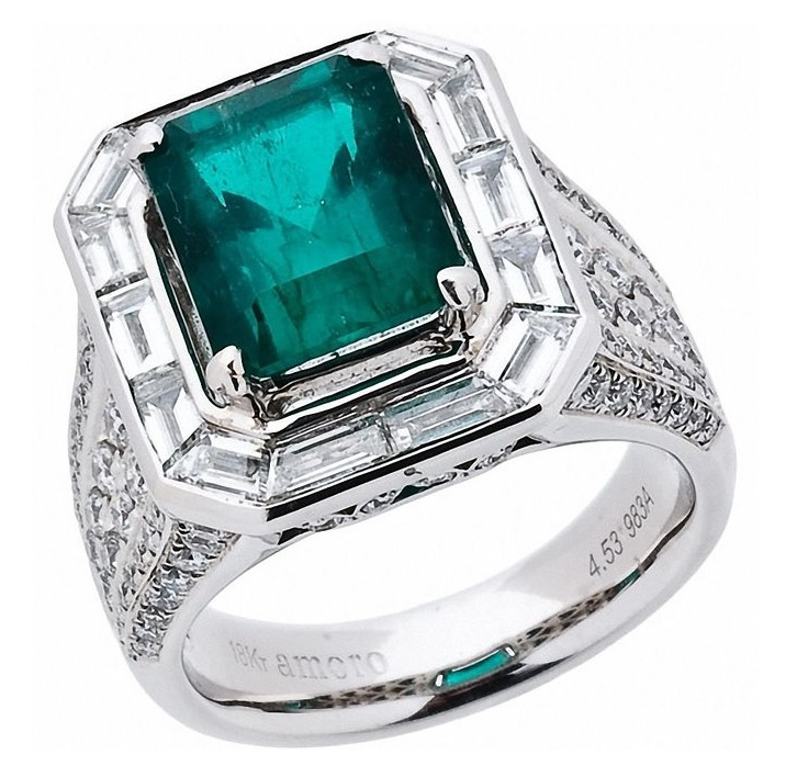 Baguette Diamonds surround this gorgeous, emerald cut green Colombian Emerald weighing over 4.5 carats