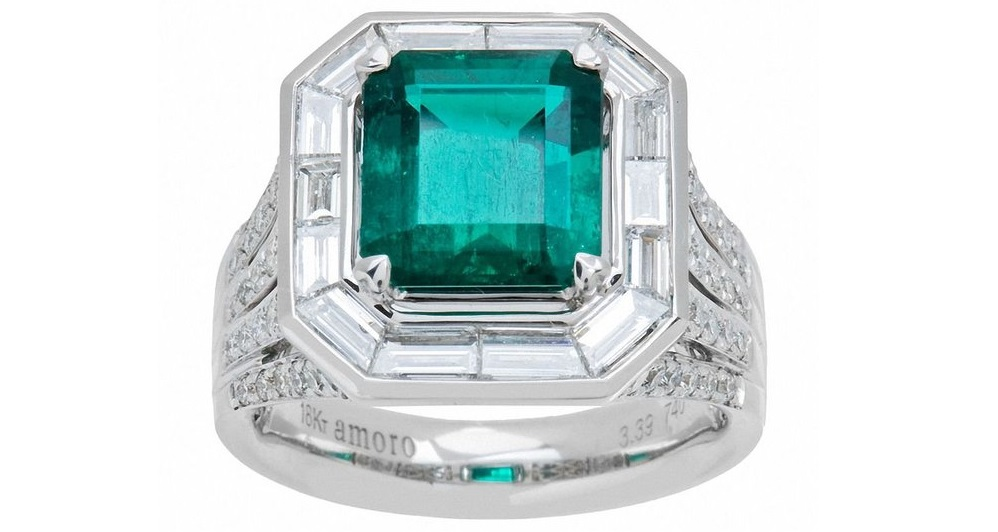 A Vivid Green Colombian Emerald and Diamond Ring in 18kt white gold