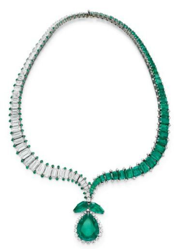 AN EMERALD AND DIAMOND NECKLACE, BY HARRY WINSTON Composed of two opposing undulating lines of graduated rectangular-cut emeralds and diamonds, enhanced by circular-cut diamond or emerald trim, tapering to a point, set with a detachable pendant comprising two modified pear-shaped emeralds, suspending a pear-shaped emerald, weighing approximately 18.95 carats, within a graduated circular-cut diamond surround, mounted in platinum
