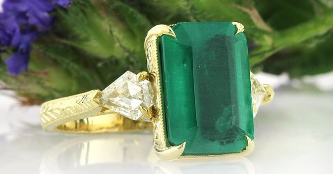 A Stunning 6.35ct Emerald and Diamond Three-Stone Ring