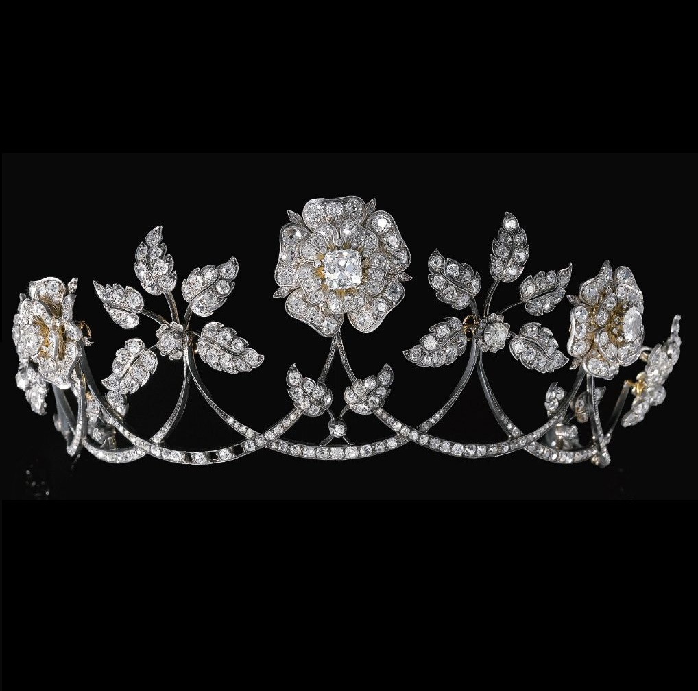 An antique diamond tiara, late 19th century. Designed as a graduated series of swags each surmounted alternatively with floral and foliate motifs, set with cushion-shaped, circular-cut and rose diamonds