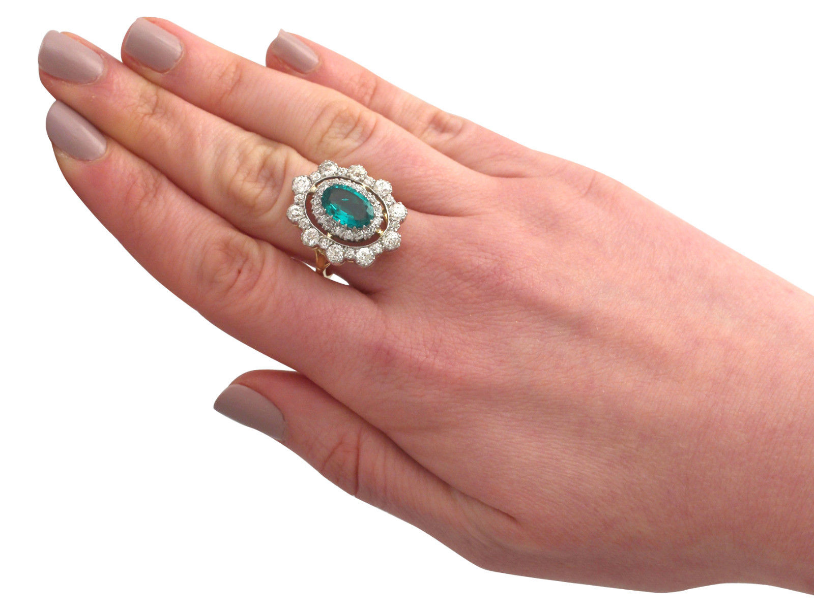 This stunning antique 1930's cocktail ring is exceptional quality set with an emerald and very well colour matched, very high colour graded old cut diamonds. The ring is an exceptional gauge of gold and is in excellent condition.