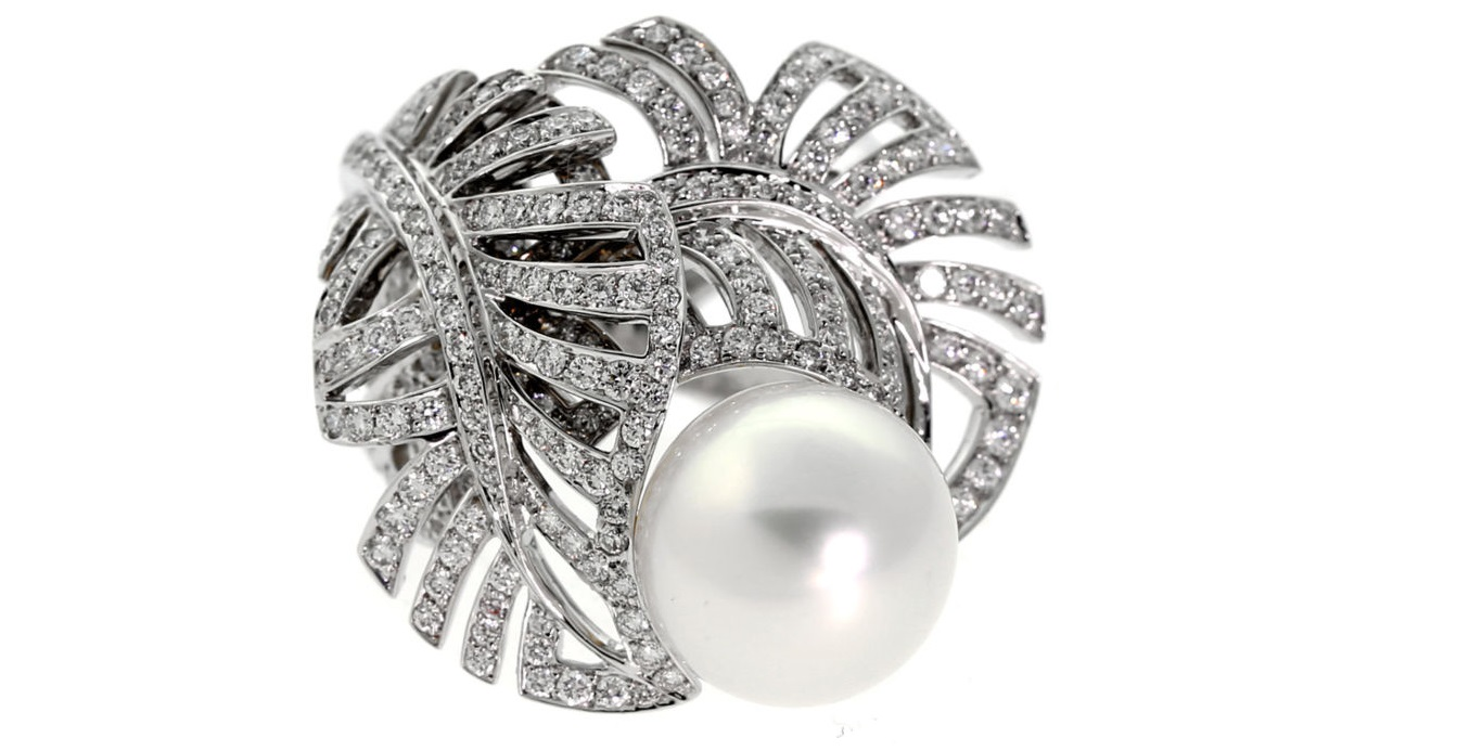 A magnificent authentic Chanel pearl and diamond ring featuring 1.72ct of the finest round brilliant cut diamonds set in 18k white gold.