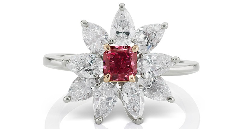 A gorgeous diamond ring with a 0.48-carat fancy purplish-red radiant-cut diamond surrounded by nine pear-shaped white diamonds (2.70 carats total) set in 18-karat white and pink gold.