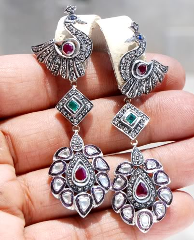 The earrings drop 2.8 inches and are 0.9 inches wide. These weigh 19.3 grams.
