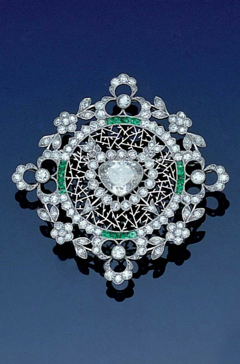A belle époque diamond and emerald brooch, circa 1905