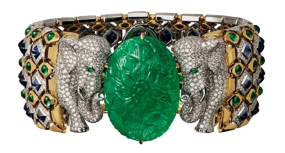 Bracelet - platinum, yellow gold, one 79.50-carat carved emerald from Colombia, cabochon-cut emeralds, cabochon-cut sapphires, emerald eyes, brilliant-cut diamonds by Cartier.
