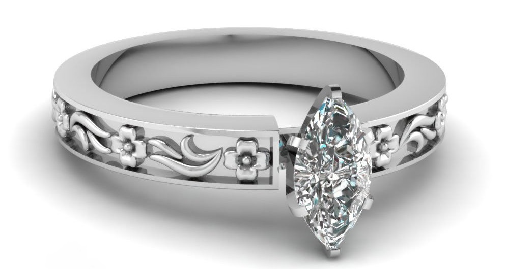 This marquise cut diamond solitaire engagement ring has a GIA Certified 0.50 Ct Diamond Cut:Very Good VVS1-D Color. This engagement ring is enhanced by a delicate floral pattern on the shank of the ring giving it an artistic appeal to it.