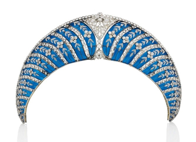 A Belle Époque enamel and diamond tiara, by Chaumet. Of kokoshnik design, composed of a series of graduated translucent royal blue plique-à-jour enamel curved panels, each overlaid with old-cut diamond trailing forget-me-not floral motifs, interspersed with collet-set diamond lines, to the cushion-shaped diamond openwork cartouche centre and similarly-set upper border, circa 1910, mounted in platinum and gold, with a later fitted case. Sold for CHF 677,000 on 10 November 2015 at Christie's in Geneva
