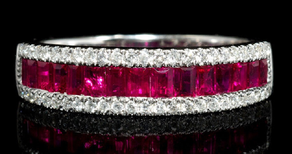 Diamond and Ruby 18k White Gold Ring This stylish 18k white gold ring, features 50 round brilliant cut white diamonds, of F color, VS2 clarity, with excellent cut and brilliance, weighing .21 carat total with 17 rubies of exquisite color, weighing 1.02 carats total.