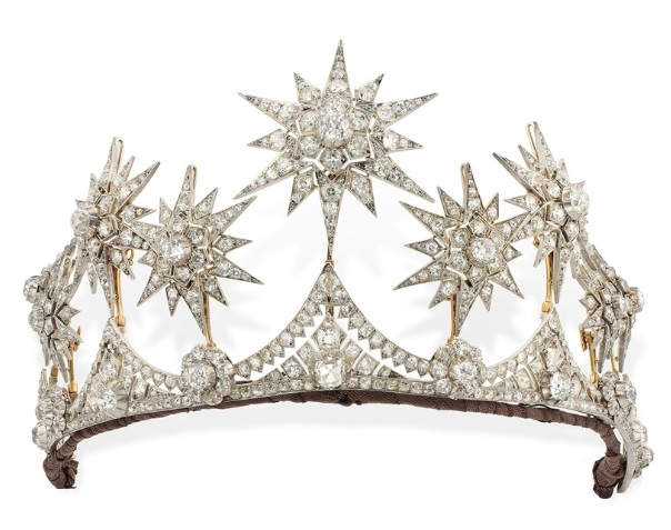 A Victorian diamond star parure, circa 1870. Comprising a tiara, the front set with six graduated old-cut diamond flowerhead clusters, each interspersed by an old-cut diamond collet and similarly-set graduated triangular intersections, surmounted by nine detachable star motifs, mounted in silver and gold. 30 cm. Sold for £317,000 on 13 June 2017 at Christie's in London