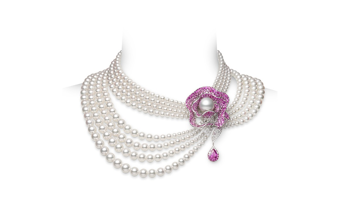 A gorgeous 18K White Gold Necklace with White South Sea Cultured Pearls. The stunning brooch is comprised of a gorgeous Akoya Cultured Pearl with Pink Sapphires and Diamonds. Created by Mikimoto